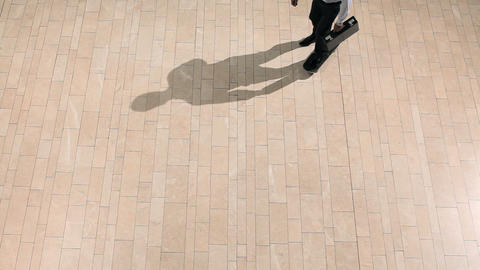 Businessman on skateboard, overhead view Stock Video Footage