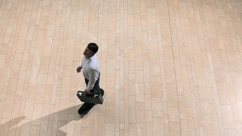 Businessman on skateboard, overhead view Stock Video Footage