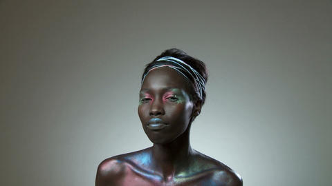 Young woman covered in metallic make up Stock Video Footage
