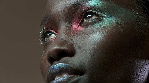 Young woman with metallic make up on face Stock Video Footage