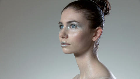 Woman with silver make up, turning around Stock Video Footage