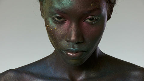 Young woman with metallic makeup on face Stock Video Footage
