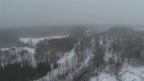Aerial view of russian frozen forest in winter near village in country side, sno Footage