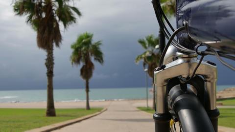 Bike moves along the bike path to the sea Footage