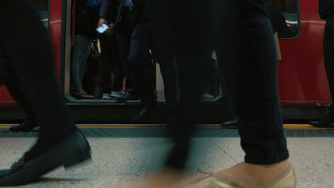 Low Angle Shot of Commuters Boarding a London Underground Tube Train Footage