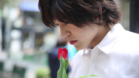 Young man smelling flower Footage