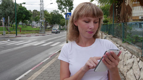 Attractive girl sends a message on his mobile phone, Live Action