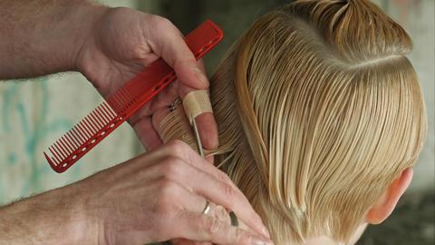 Beautyful Girl getting haircut. Conceptual Footage