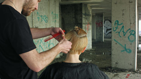 Hairdresser giving a new haircut Footage