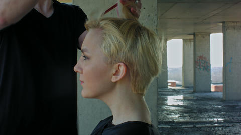 Beautiful blond woman gets a hairdress Footage