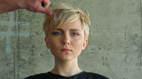 Final touch by hairdresser. Blond girl hairdress Footage