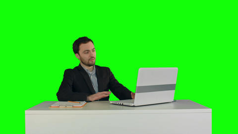 Smiling Businessman in the office on video conference, Skype on a Green Screen Footage