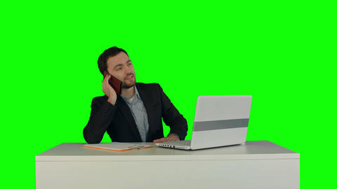 Young business man speaking on the phone in office. on a Green Screen Footage