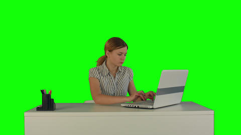 Businesswoman working on laptop on a Green Screen Footage