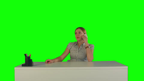 Business woman in office with phone on a Green Screen Footage
