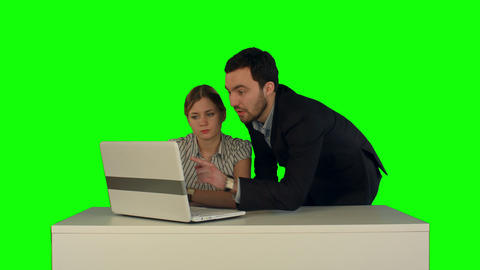 Couple discussing new project on the laptop. Teamwork concepts. on a Green Scree Footage