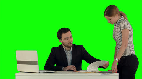 Angry boss with female worker in office on a Green Screen Footage