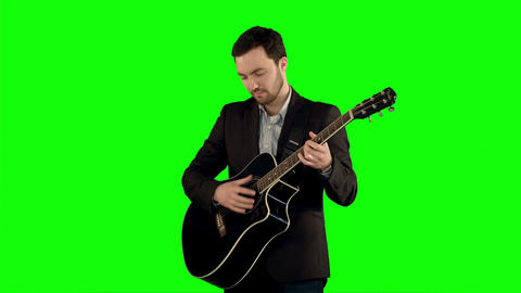 Young man playing guitar on a Green Screen Footage