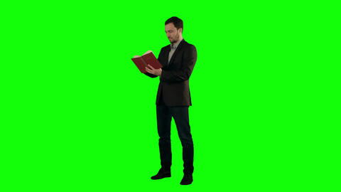 Young student reading a law book on a Green Screen Footage