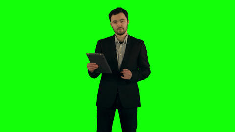 Businessman using his tablet on a Green Screen Footage