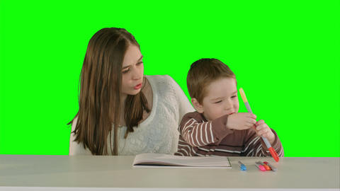 Happy family mother and child painting together on a Green Screen Footage
