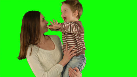 Happy family having fun on a Green Screen Live Action