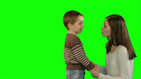 Photo of the happy young family with children looking up on a Green Screen Footage