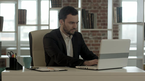 Young Stressed Businessman Working On Computer Laptop Late At Night In Suit And  stock footage