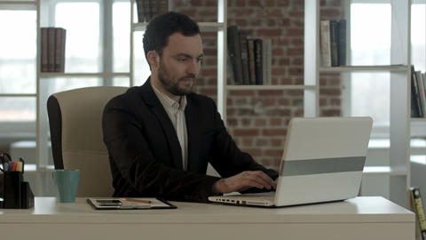 handsome businessman at office close notebook, stop working Footage