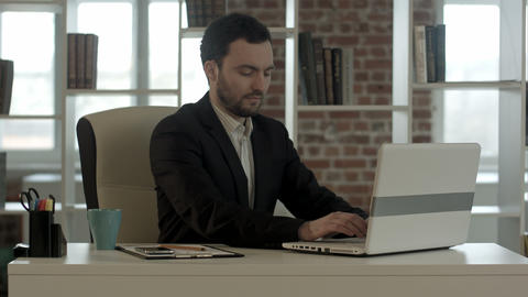 businessman finished work in front of a laptop Footage