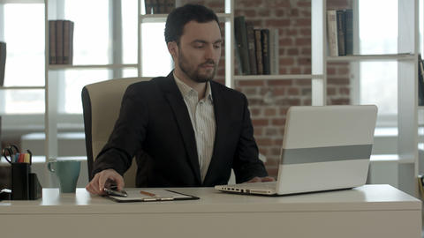 Young businessman start working with a laptop Footage