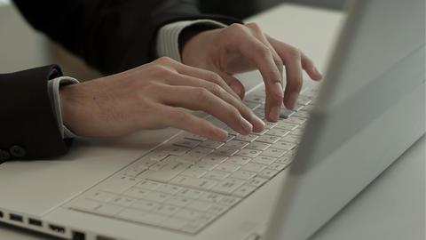 Man typing on laptop computer keyboard Footage