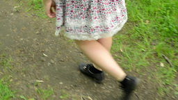 feet walks in the park - young woman - close up - stedicam Footage