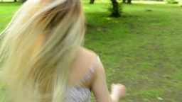 young attractive woman runs in the park with loose hair - steadicam - closeup Footage