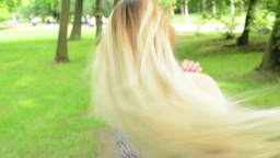 young attractive woman runs in the park with loose hair - steadicam Footage