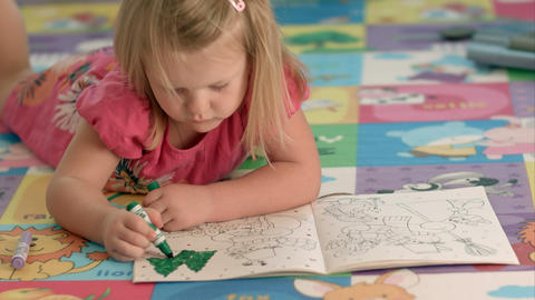 Cute little girl is drawing with felt-tip pen Footage