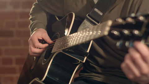 Man playing guitar on a stage. Musical concert. Close-up view Footage