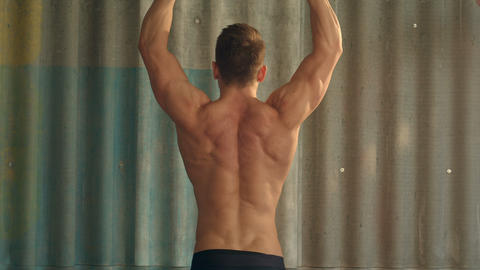 Young muscular man exercising with dumbbells Footage