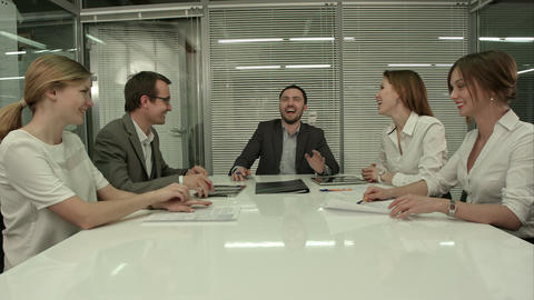 Casual Business Team Laughing During Meeting In The Office stock footage