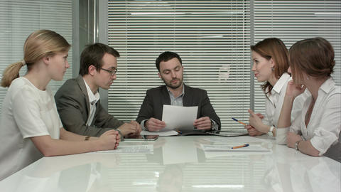 young business people group have meeting at conference room and have discusion a Footage