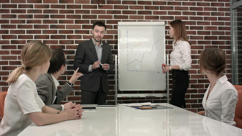 business, education and office concept - serious business team with flip board i ภาพวิดีโอ