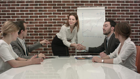 Businesswoman giving presentation on flipchart. Business meeting in the office Footage