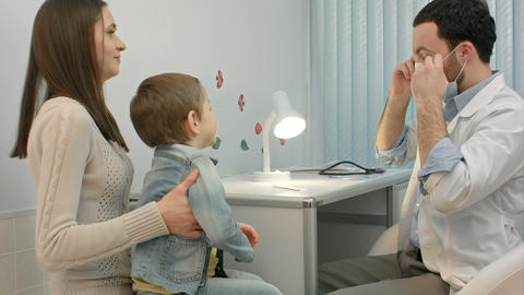 Pediatrician checking little boy throat Footage