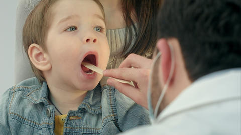 Little boy having throat examination Footage