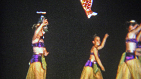 1957: Arabian style school performance by young girls costumed dance troupe Footage