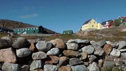 Greenland small town Qaqortoq 067 street in upper village behind stone wall Footage