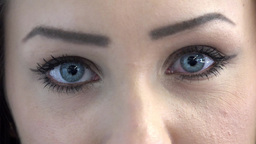 eyes of young attractive woman - detail (closeup) Footage