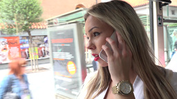 young attractive blonde woman traveling by tram and phone with smartphone - clos Footage