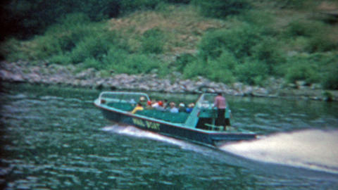 1957: Mail boat taking tourists up river sightseeing and dropping postage along  Footage