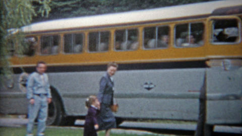 1959: Family entering luxury travel tour bus to travel across America trip Footage